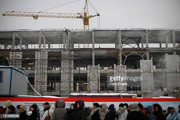 People forma queue in front of a construction site on November 9 2011 in Saransk Russia Saransk is the smallest of the thirteen proposed host cities...