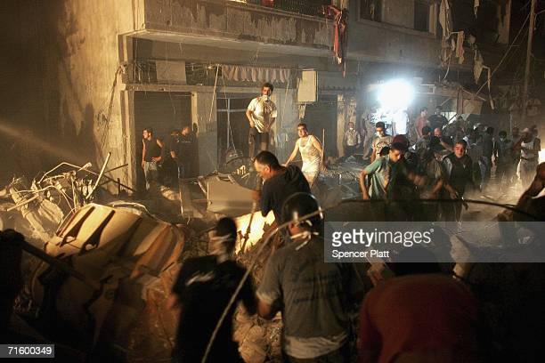 People frantically try to rescue survivors at the scene of a building collapsed due to an Israeli attack on August 7 2006 in Beirut Lebanon The...