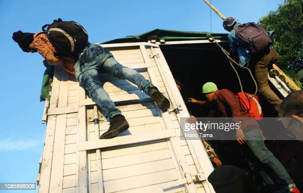 People from a caravan of Central American migrants help prepare a truck some were using to travel to the United States on January 21 2019 in...