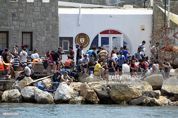 People from a group of 280 illegal immigrants trying to reach Greece's Kos Island from Mugla's Bodrum District are seen on a port after the rescue...
