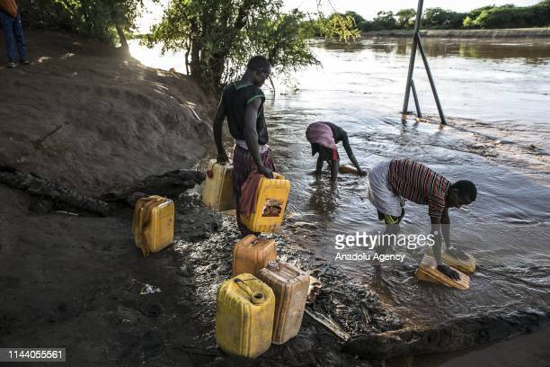 People from a refugee camp where nearly 9000 Kenyans Ethiopians and Somalians live fill barrels with water of Juba River in Doolow town of Gedo...