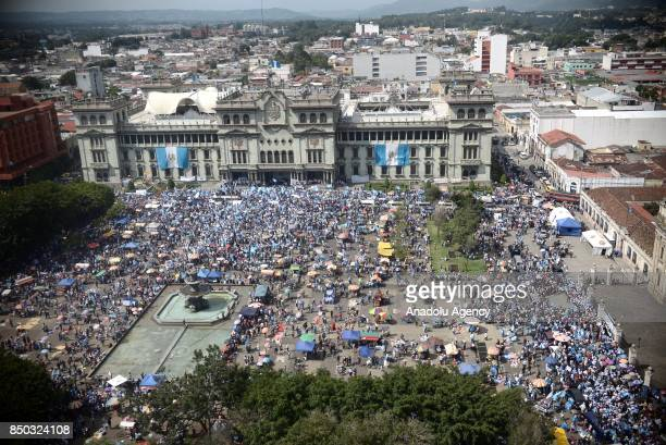 People from all over the country gather in front of the presidential palace asking for the resignation of president Jimmy Morales and 107 congress...