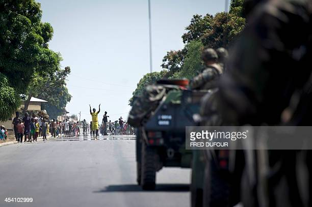 People from Bouar welcome French militaries arriving from Cameroon on December 7 2013 France deployed nearly 1000 troops on December 6 2013 to help...