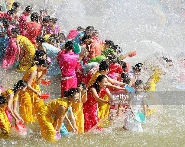People from Dai minorities perform the Water Splashing Festival at a Dai village on the bank of the LancangMekong River on July 7 2005 in...