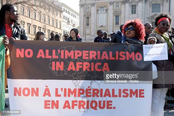 People from different African communities in Italy protest against the French government for the abolition of the Francophone Africa Colony Franco...