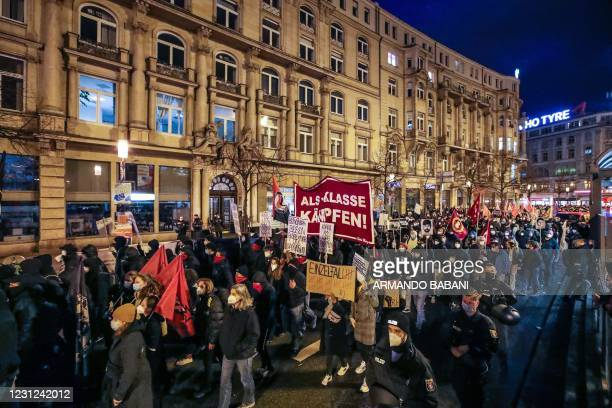 People from different organisations march during a demonstration to commemorate the victims of the 2020 Hanau shooting in Frankfurt am Main, western...