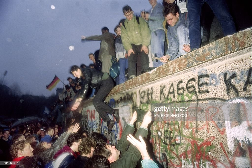 People from East Germany greet citizens of West Germany at the Brandenburg Gate in Berlin on December 22, 1989. On November 09, Gunter Schabowski, the East Berlin Communist party boss, declared that starting from midnight, East Germans would be free to leave the country, without permission, at any point along the border, including the crossing-points through the Wall in Berlin. The Berlin concrete wall was built by the East German government in August 1961 to seal off East Berlin from the part of the city occupied by the three main Western powers to prevent mass illegal immigration to the West. According to the 'August 13 Association' which specialises in the history of the Berlin Wall, at least 938 people - 255 in Berlin alone - died, shot by East German border guards, attempting to flee to West Berlin or West Germany. PATRICK