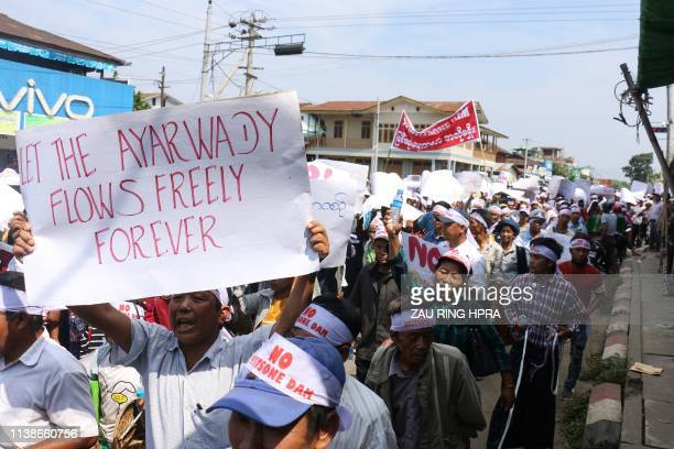 People from Kachin State take part in a protest against the Irrawaddy Myitsone dam project in Waimaw near the Myitkyina capital of Kachin State on...