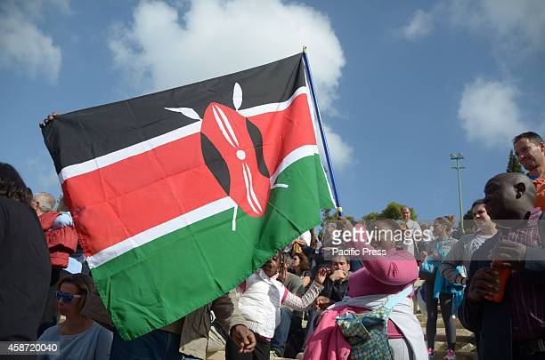 People from Kenya hold a flag of their country At he 32nd Athens Marathon the Authentic was organised in Athens with thousands of Marathons runners...