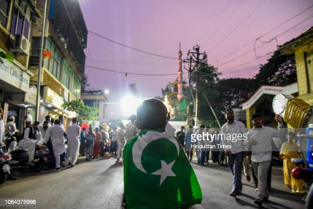 People from Muslim community take part in processions to celebrate birth anniversary of Prophet Muhammad Paigambar at Babajan chowk in Camp, on...