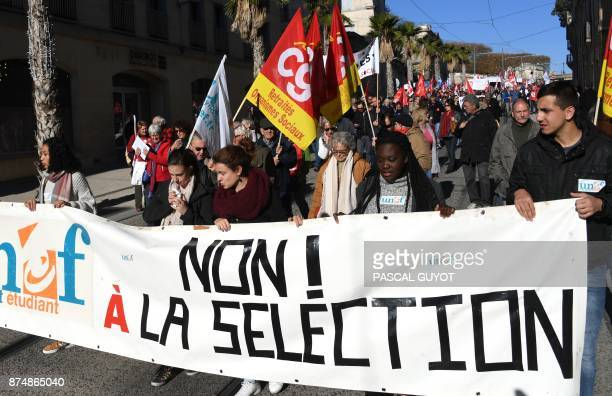 People from student union UNEF hold a baller reading 'no to selection' as they as they demonstrate during a nationwide protest day against the...