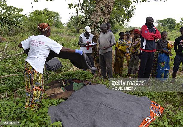 People from the Christian community cover the bodies of five people three AntiBalaka fighters and two presumed civilians who were killed during...