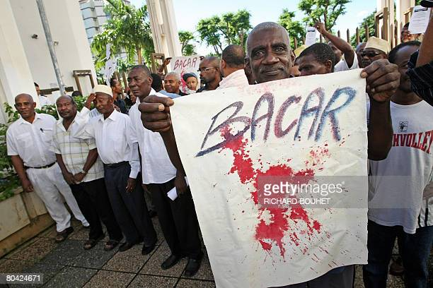 People from the Comoros demonstrate in front of the Courthouse in Saint Denis on the French island of La Reunion on March 29 against the ousted rebel...