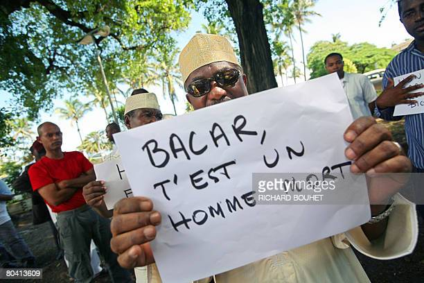 People from the Comoros demonstrate on March 28 2008 in Saint Denis on the French island of La Reunion against the ousted rebel leader of the Comoros...