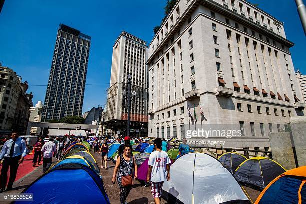 People from the Homeless Workers' Movement set up their tents to protest against the government in front of the city hall of Sao Paulo at the Cha...