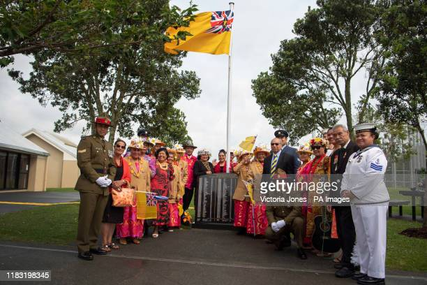 People from the island of Niue in the South Pacific welcome the Prince of Wales and the Duchess of Cornwall as they arrive for a wreath laying...