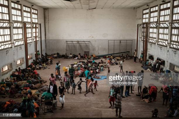 TOPSHOT People from the isolated district of Buzi take shelter in the Samora M Machel secondary school used as an evacuation center in Beira...