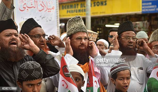 People from the Muslim community giving Azaan during the protest march to mark the 24th anniversary of the demolition of the Babri Masjid at Minara...