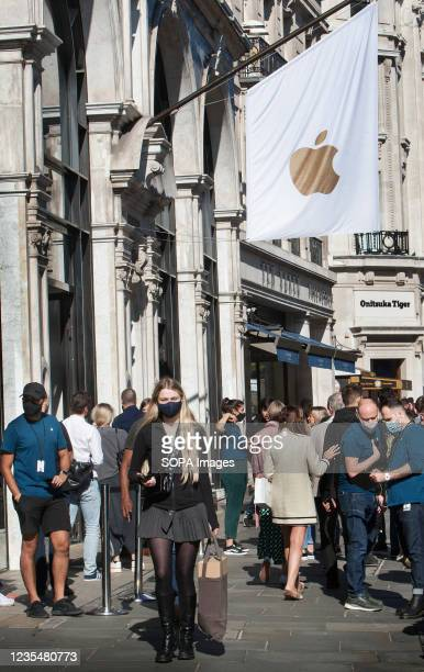 People from the public queue outside the Apple Store in Regent Street, London on the first release day of the iPhone 13.