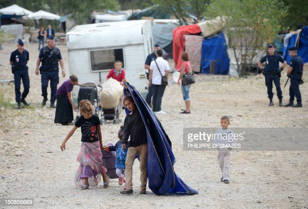 People from the Roma community leave their camp after being expelled by French police officers on August 28 in SaintPriest outside Lyon...