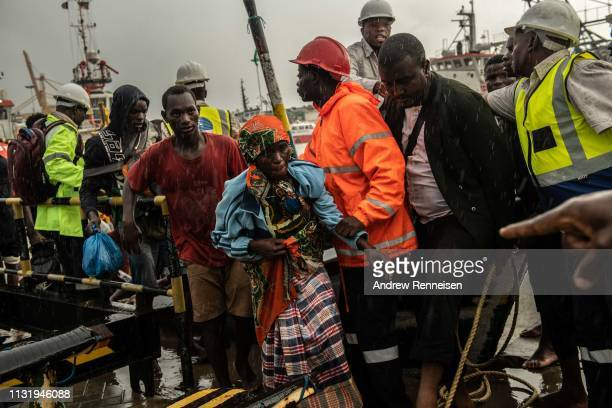 People from the town of Buzi unload at Beira Port after being rescued on March 22 2019 in Beira Mozambique Thousands of people are still stranded...