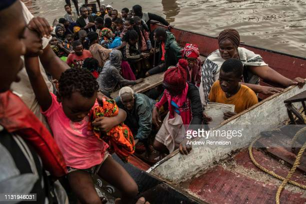 People from the town of Buzi unload from a boat at Beira Port after being rescued on March 22 2019 in Beira Mozambique Thousands of people are still...