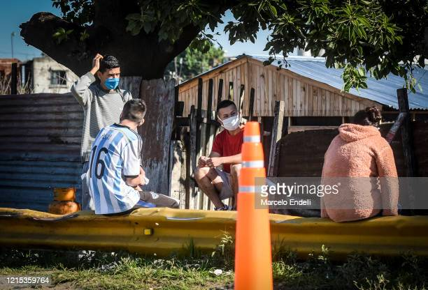 People from the Villa Azul neighborhood wait for a gas cylinder on May 26 2020 in Buenos Aires Argentina The slum remains isolated by authorities...