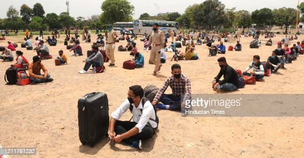 People from Uttarakhand waiting for special buses to take them home at sector 34 Exhibition Ground on May 4 2020 in Chandigarh India