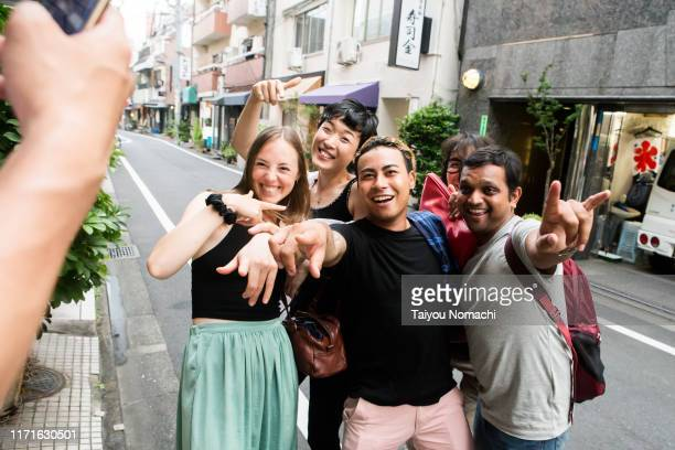 people from various countries taking a commemorative photo on the street - asia pac stock pictures, royalty-free photos & images
