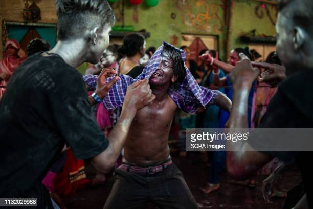 People full of colours seen dancing in a cheerful mood during the celebration Holi known as the festival of colour is an ancient Hindu spring...