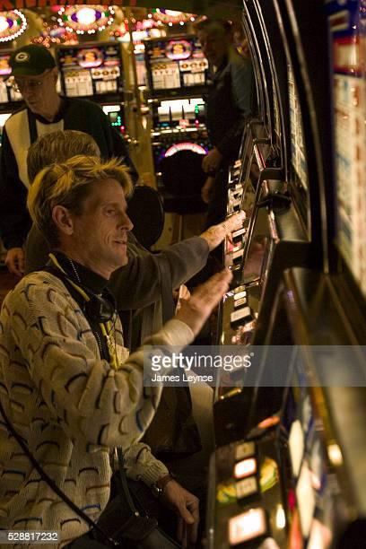 People gambling at slot machines at a casino in Las Vegas