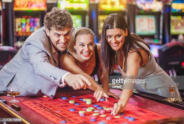 people gambling in the casino - casino stock pictures, royalty-free photos & images