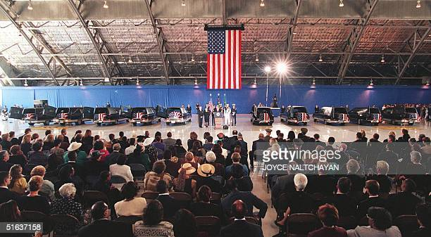 People gather 13 August at Andrews Air Force Base MD for a memorial service for 10 of the 12 US victims killed 07 August in the US Embassy terrorist...