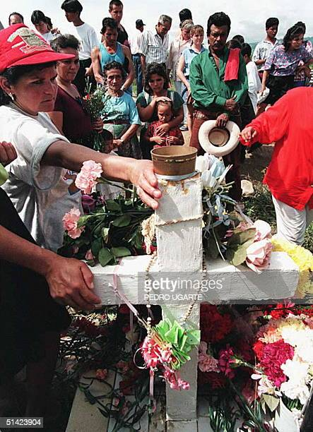 People gather 13 November around the grave of Omaira Sanchez one of the victims of the 1985 mudslide spawned by the eruption of the Nevado del Ruiz...