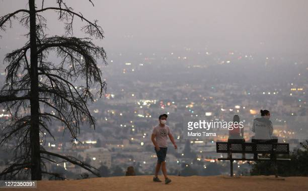 People gather after sunset amid smoke from wildfires at Griffith Park on September 13, 2020 in Los Angeles, California. Air quality was deemed...