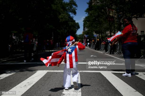 People gather along 5th Avenue during the National Puerto Rican Day Parade on Sunday June 11 2017 in New York