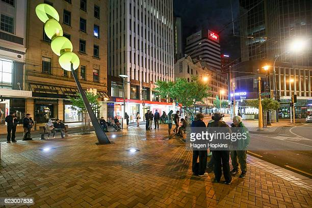 People gather along Lambton Quay after an earthquake on November 14 2016 in Wellington New Zealand The 75 magnitude earthquake struck 20km southeast...