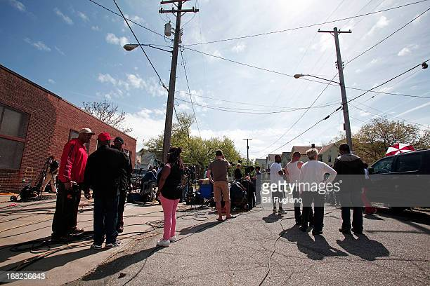 People gather along Seymour Avenue near the house where three women who disappeared as teens about a decade ago were found alive May 7 2013 in...