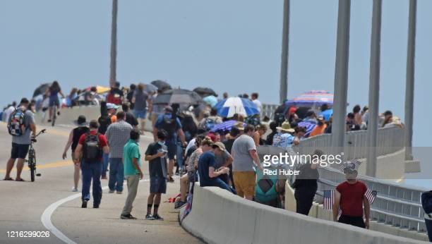 People gather along the AMax Brewer Causeway ahead of the launch of a SpaceX Falcon 9 rocket from Cape Canaveral Florida May 30 2020 in Titusville...