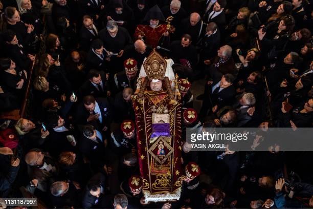 TOPSHOT People gather and mourn next to the coffin of late Armenian Patriarch in Turkey Archbishop Mesrob II Mutafyan at Surp Asdvadzadzin...