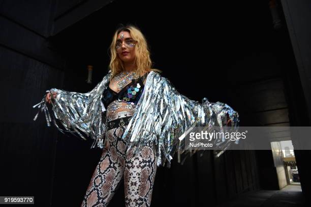 People gather and pose for photographs outside the BFC Showspace during London Fashion Week February 2018 London on February 17 2018