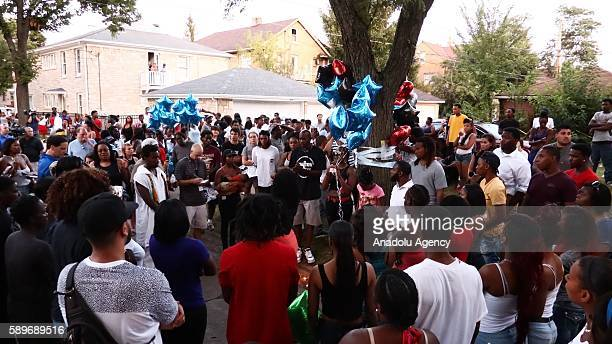 People gather and pray during a commemoration ceremony, held for Sylville Smith, who was shot and killed by a police officer as he reportedly...