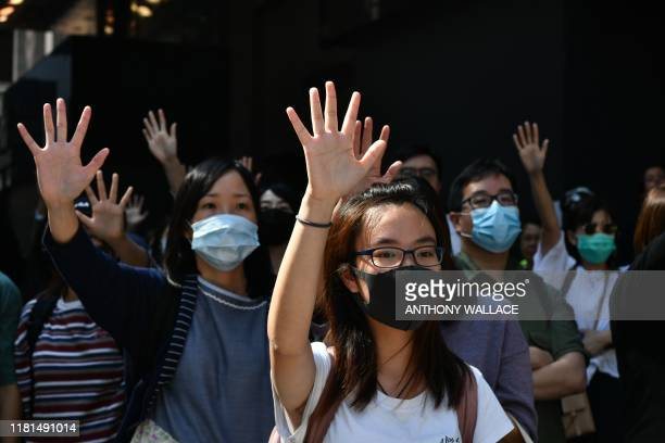 People gather and shout at the police after a prodemocracy protester was shot by a policeman in Hong Kong on November 11 2019 A Hong Kong police...