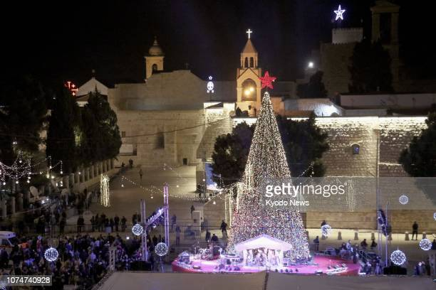 People gather around a Christmas tree near the Church of the Nativity in Bethlehem on Dec 24 2018 ==Kyodo