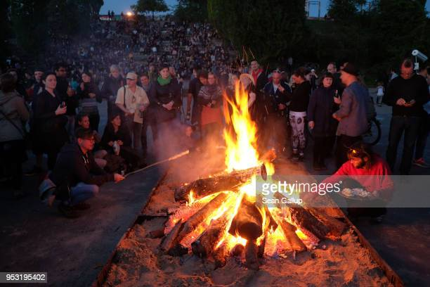 People gather around a fire at Mauerpark on Walpurgis night on April 30 2018 in Berlin Germany Walpurgis is traditionally the night of witches in...