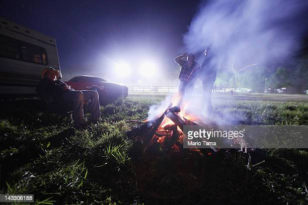 People gather around a fire at the Owsley County Saddle Club trail ride on April 19 2012 in Booneville Kentucky The trail ride attracts riders from...