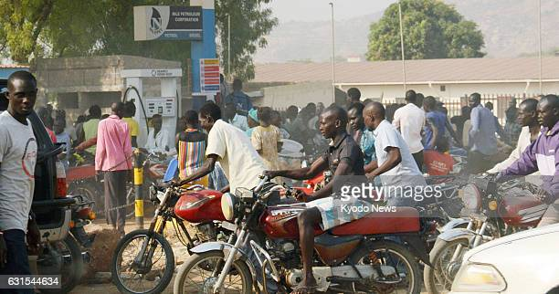 People gather around a gas station in South Sudan's capital Juba on Jan 10 as the country's economic crisis deepens due to a prolonged civil war
