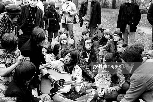 People gather around a guitarist at Thompkins Square Park on the Lower East Side circa April 1968 in New York New York