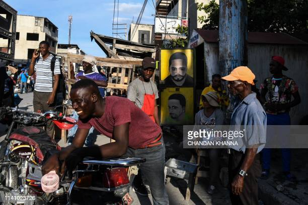 People gather around a local market in downtown in PortauPrince on May 3 2019