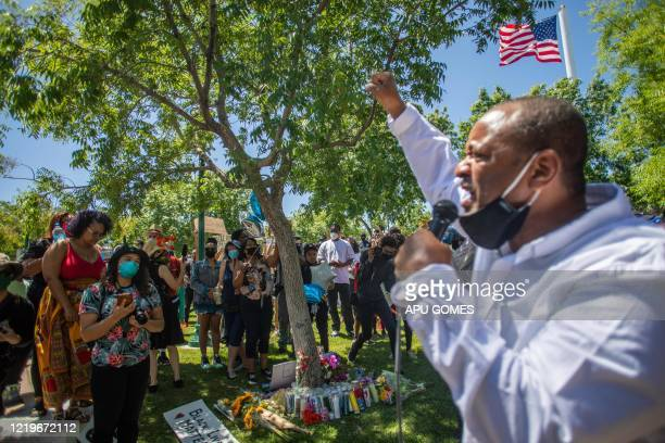 TOPSHOT People gather around a makeshift memorial at the tree where Robert Fuller was found dead outside Palmdale City Hall on June 13 2020 to demand...